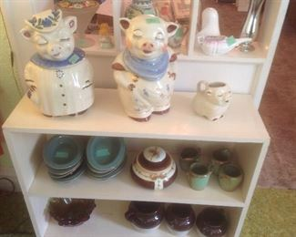 Shawnee smiling pig cookie jars and creamer.  Also have salt and pepper.