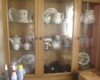 Jewel tea pieces and other sets of tea pots and cups.  Sitting inside a vintage China cabinet.  Glass doors on top and wooden doors on bottom.  Presale..$125