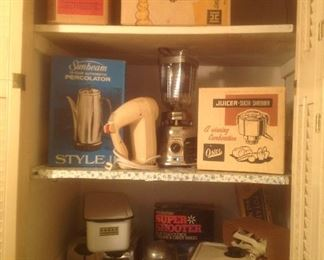 Vintage small appliances in their original boxes