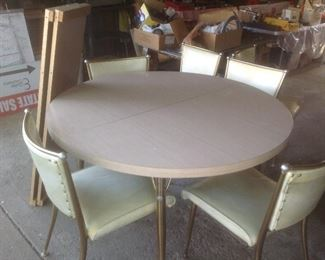 Vintage Formica table with two leaves and six chairs...presale $195