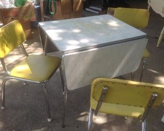 Vintage Formica drop leaf table with three bright yellow chairs.   Presale.....$125