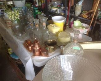 Tables full of metal , glass, and other household items