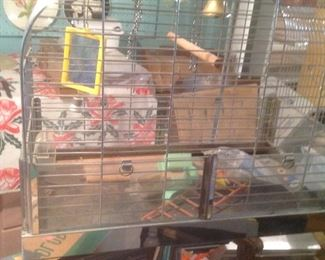 Birdcage on a stand with many items within cage.....presale at $100