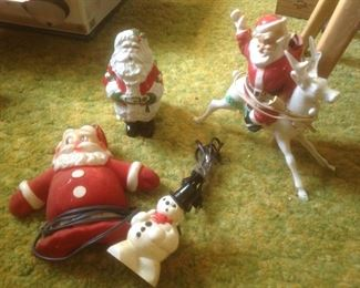 Four very old Xmas pieces...three are electric but without a light....Santa in upper left is a vintage planter