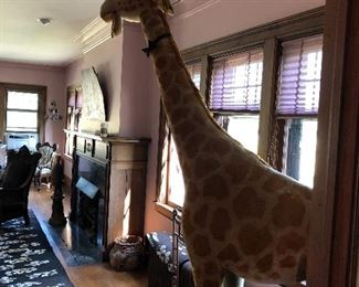 Approximately 9 foot tall Stieff giraffe ( The backside has some damage and will need repair )
