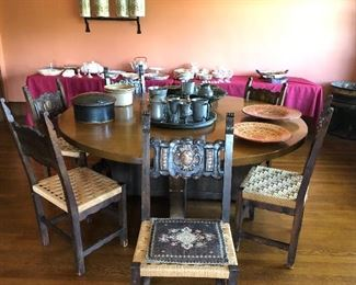 Large round oak table from the Cleveland Public Library now used as the dining table.
