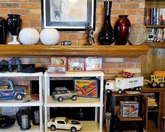 Tonka large dump truck, road grader, Steak and Shake truck, Trans Am cars, Datsun Z car, Blazer and more. Metal LUNCH BOXES – most with thermos: Evel Knieval, Space 1999, Speed Buggy, Road runner, 6 million dollar man, Johnny Lightening
