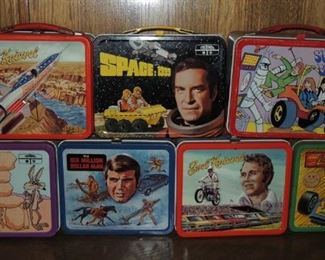 Metal lunchboxes – most with thermos: Evel Knieval, Space 1999, Speed Buggy, Road runner, 6 million dollar man, Johnny Lightening