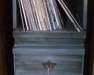 Bedside tables (shown stacked) and records