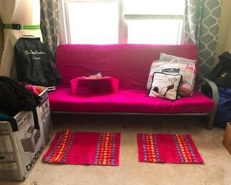 hot pink futon! Perfect to give your daughter who is off to college and you want to repel her possible beaus.