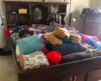 Okay, this is a 70s waterbed frame! Cher filled it with stuff! I haven't seen one of these since our mother bought one after she divorced our dad in 1977!