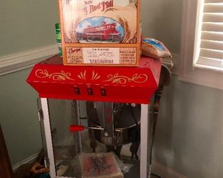 POPCORN machine!! Entertain the neighborhood with movie nights and okay no need for excuses just buy this to eat movie popcorn by yourself every night