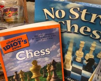 """lots of chess stuff! """"Can you please teach me to play chess?"""" is something I never said to anyone. Why? Because I can just BUY THESE BOOKS!"""