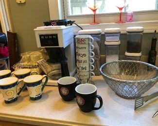 Lots of coffee cups and coffee makers!