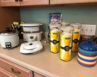 rice cookers and beer steins -- bachelor starter kit (turns out those are not beer steins but canisters for storing pasta)
