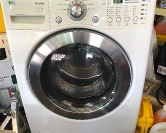LG washing machine, located in garage and its in working order.  The matching Dryer is upstairs in home. We don't ask why