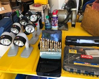 Lights and drill bits and tools you can literally build a library with things strictly bought from this estate sale