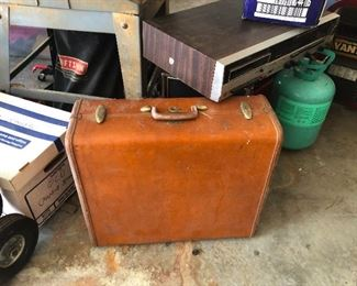 Leather suitcase for when the Wells Fargo Wagon is a coming down the street