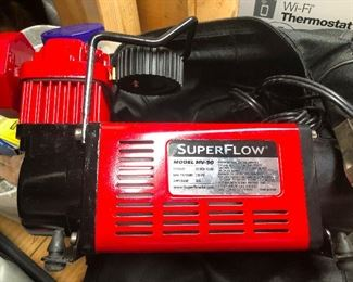 SuperFlow, by the time this sale starts on Wednesday I will know what that is and have priced it appropriately -- it's a SuperFlow portable air pump!! See! Told ya!