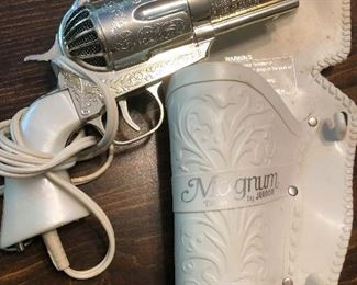 gun of some kind -- oh, wait, it's a HAIR DRYER