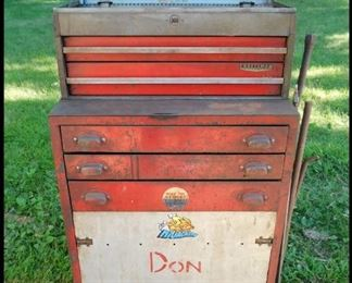 Roll Around Toolbox with Two Drawer Craftsman  Toolbox  on top.