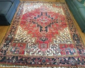 "Ah, here it is - the Persian Heriz rug you've been looking for! This cutie measures 10' 6""  x 8'."