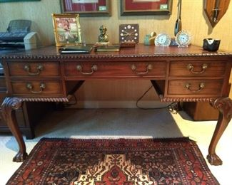 Vintage English mahogany partner's desk, with maroon tooled leather top.