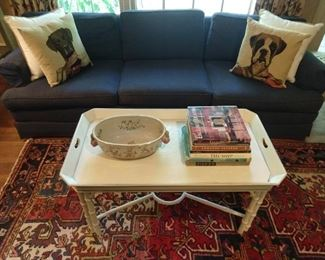 Faux bamboo tray cocktail table, with stretcher, one of a matched pair of sofa and pull-out sleeper sofas, fun tapestry dog pillows, stuffed with Yves Delorme down cushions, fabby Persian Heriz rug!
