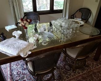 MCM glasstop dining room table (not pictured - matching side table), bamboo swivel chairs, linens and crystal.