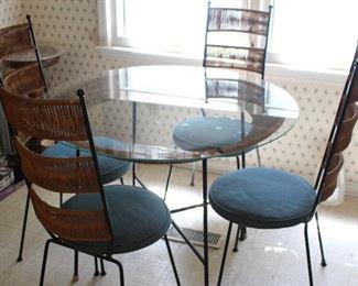 Vintage round glass/iron/wicker dining set.