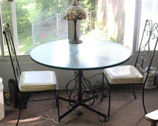 Vintage round glass and iron patio set.