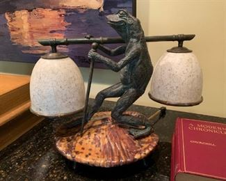 Maitland Smith dual shade bronze frog lamp resting atop a tortoise shell tone footed lily pad.