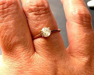 .70 carat European cut diamond on simple 14K band.
