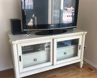"42"" SHARP LCD flat screen TV.   TV stand w/glass front and storage drawers."
