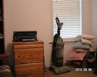 2 drawer wooden file cabinet. Hoover wind tunnel vacuum, barely used. Assorted throw pillows.
