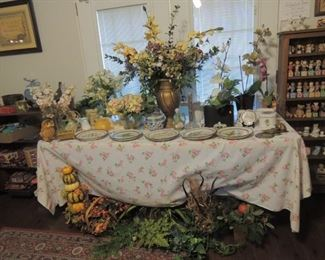 table full of flower  arrangements, spring and fall also Ethan Allen flower plates and vintage and brass flower pots