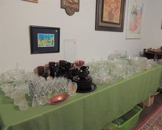 Cape code and a table full of  vintage pressed glass and crystal pieces