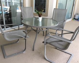 Metal outside table with four chairs, excellent condition!