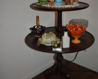 Two-tiered round edge Duncan Phyfe Antique Table adorned with Wonderful Collectibles