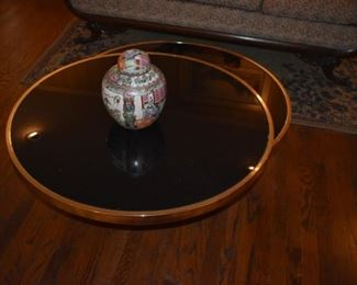 Gorgeous Art Deco Style Coffee Table. Table Swivels to make 2 round Glass Top Surfaces trimmed with Gold Colored Rims.