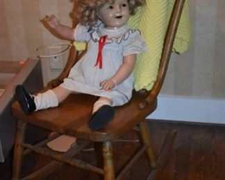 Antique Shirley Temple Doll waving to you from Her Antique Rocking Chair!