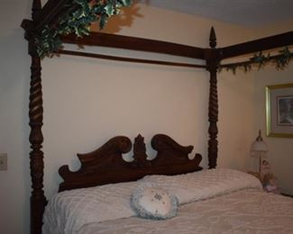 Gorgeously Carved Bedroom Suite featuring Barley Twist, Pie Crust Edging, Claw Feet, and More. Bedroom Suite consists of Mirrored 8 Drawer Dresser, Highly Carved 4 Poster Bed and 2 matching End Tables!!!