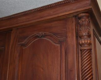 Beautifully Carved Armoire featuring Rope twist sides accented with Tudor Leaf Carvings, 8 Drawers and Shelving behind the Double Doors.
