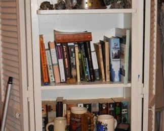 Collectibles from Wizards, Unicorns, etc. to Medievel Helmet style Liquor Container to Mugs to Paperbacks, etc.