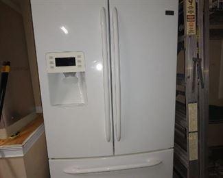 GE Profile Refrigerator with Cafe Doors & Bottom Freezer.