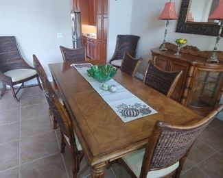 Tommy Bahama Table with 2 Leafs, 6 Mangrove Side Chairs & 2 Cruz Bay Host Chairs.  Exclusive Statement Dining Room Set.  Check out original pricing at Kalin Furniture in Ormond Beach Over $12,000 New! Big Opportunity to purchase during this sale!!
