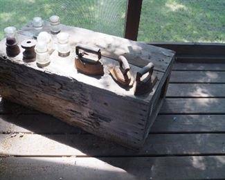 wood box with irons, insulators
