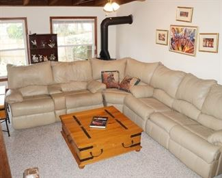 Leather sectional with recliners on the 2 seat side, pull out bed on 3 seat side.  WEIGHS A TON!  Bring friends and a truck.  We absolutely can not help load!