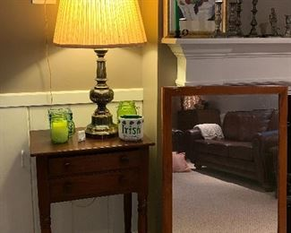 Large mirror w/wood frame, side table and brass lamp
