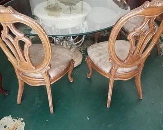 5 matching chairs for glass dining table. $1,000 - (included with the glass dining table)